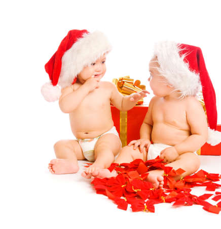 Two toddlers  in xmas hats photo