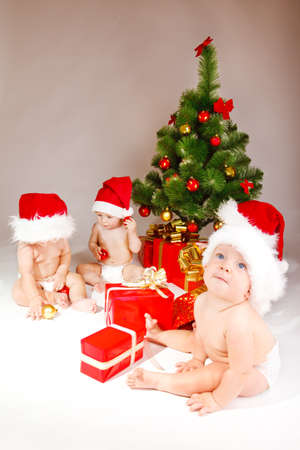 Four friendly kids enjoying Christmas time photo