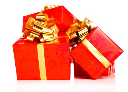 A pile of present boxes wrapped into red paper photo