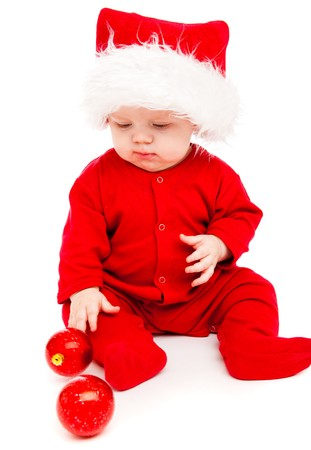Little boy in a large Santa hat photo