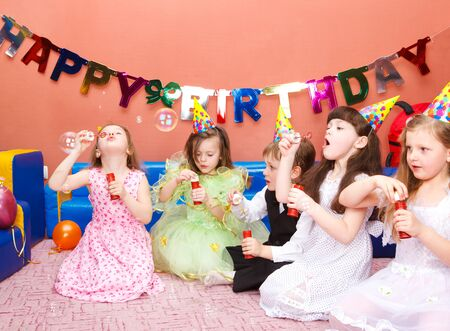 birthday suit: Preschool kids with soap bubbles at the birthday party Stock Photo