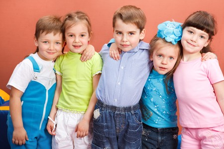 Group of attractive preschool kids embracing photo