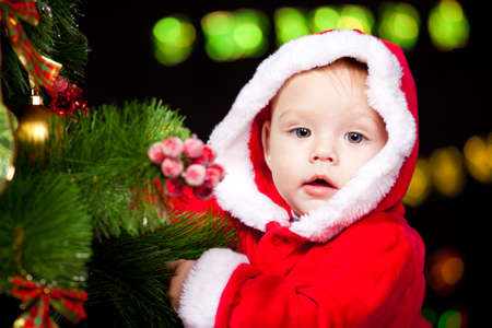 Portrait of a baby decorating Christmas tree photo