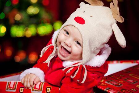 baby kerst: Gelukkig baby herten  Stockfoto