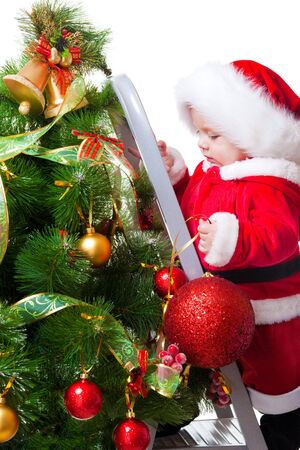 Baby on the step ladder decorating Christmas tree