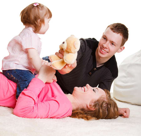 Parents playing with toddler girl Stock Photo - 8168600