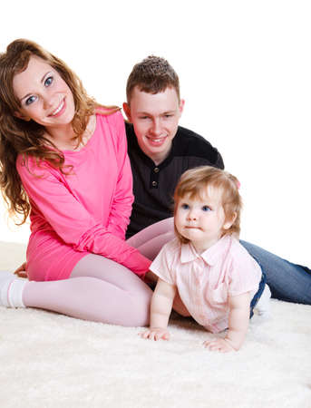 Young parents happy to play with baby daughter photo