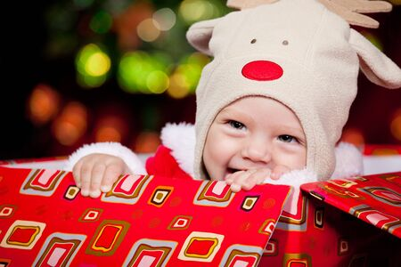 Cheerful baby in deer hat sitting in the box Stock Photo - 8168608