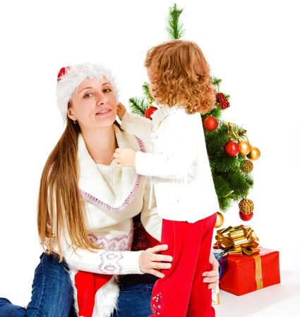 Daughter helping mom with her Christmas hat Stock Photo - 8168627