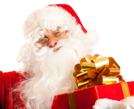 Portrait of Santa Claus with present box in hand photo
