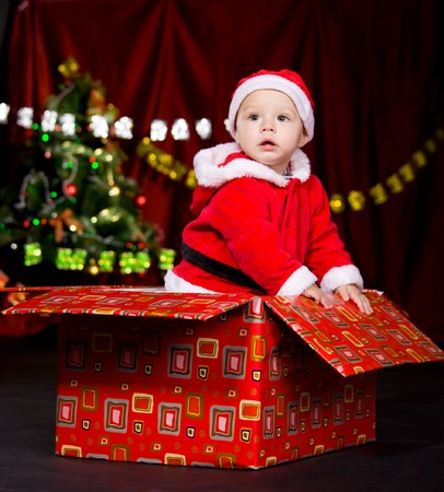 Little cute present in Santa costume photo