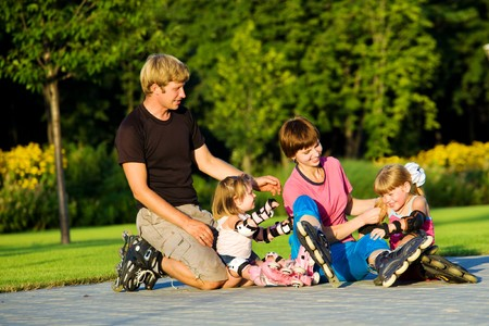 inline skates: A happy family in roller skates