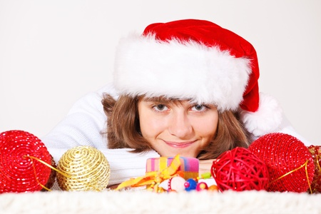 Lovely teenage girl lying among red Christmas balls Stock Photo - 8372988