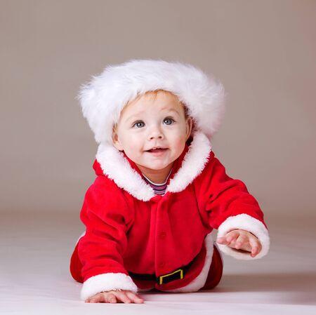 Crawling Christmas baby, over grey Stock Photo - 8372925