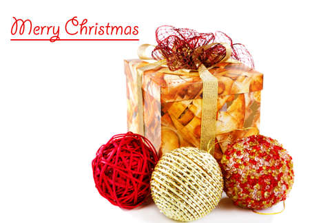 Merry Christmas card with present box and balls beside Stock Photo - 8373171