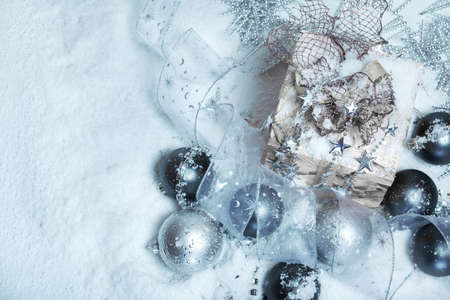Christmas decoration lying on snow Stock Photo - 8373187
