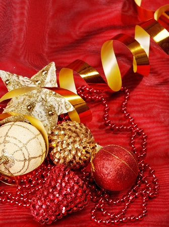 Christmas accessories on red fabric photo