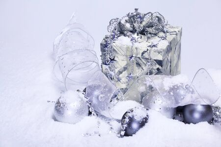 Christmas decoration and present covered with snow photo