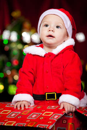 Lovely infant in Santa costume  photo