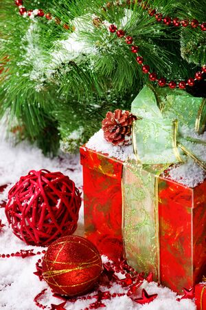 Red gift box under Christmas tree photo