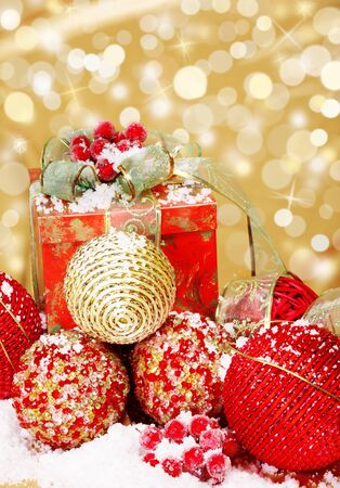 Red and golden Christmas supplies on glittering background photo