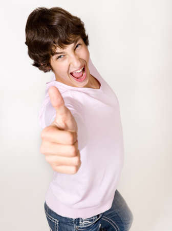 An excited handsome teenager with his thumb up Stock Photo - 8590798