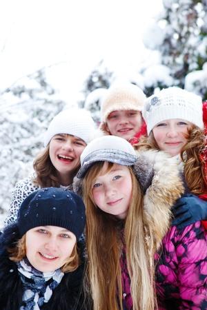 Five cheerful teenage girls looking into camera photo