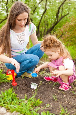 Happy family time in a spring garden photo