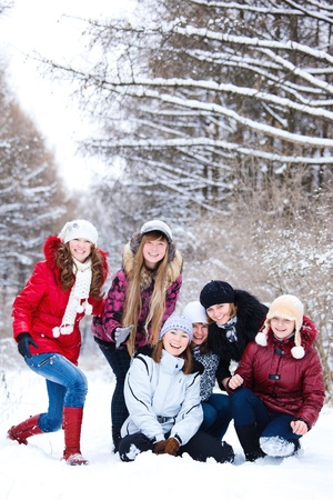 Teenage girls in warm clothing laughing photo