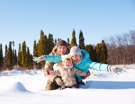 A young loving family enjoying vacation in snow photo