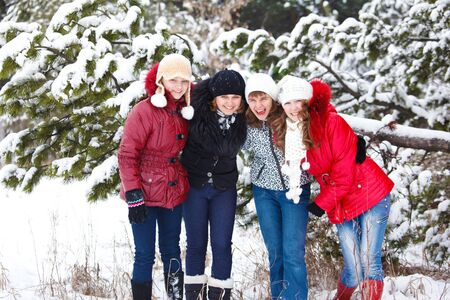 Four teenage girls embracing in winter park Stock Photo - 8797225