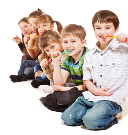 A group of kids cleaning teeth, isolated photo