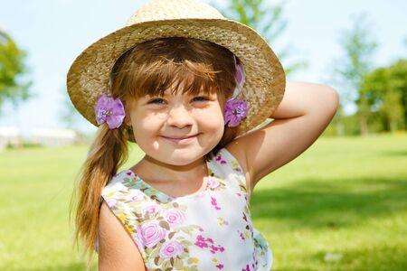 Attractive Caucasian girl in a straw hat Фото со стока