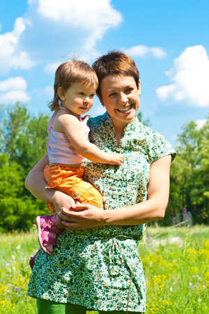 Mother and little daughter in hands, laughing Stock Photo - 8797242