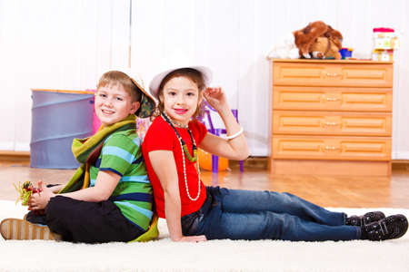 Cheerful boy and girl in trendy clothing photo