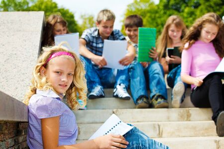 Group of teenagers reading books in the outdoor Stock Photo - 8864940