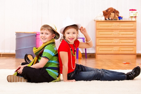 Stylish boy and girl sitting back to back Stock Photo - 8801314