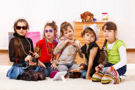Five fashionable little girls with stylish accessories on Stock Photo - 8801283