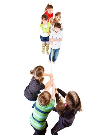 Cheerful preschooler teams pulling rope, over white photo