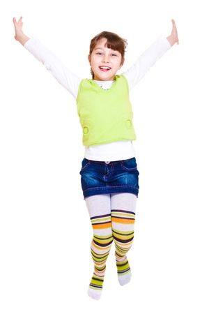 A pretty cheerful girl jumping Stock Photo - 8801353