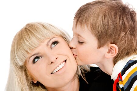 Portrait of a preschool boy kissing his mother photo