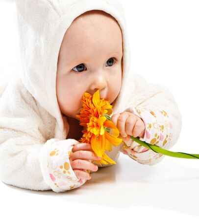 Adorable baby with orange flower photo