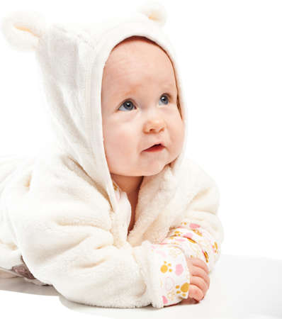Surprised baby looking up photo