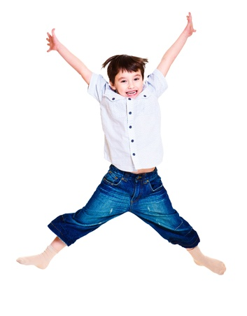 A cute excited boy jumping Stock Photo