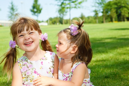 Cheerful little girls in park photo