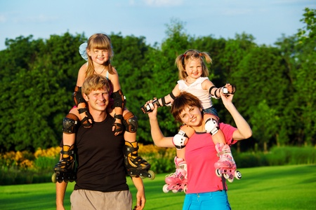 Sportive parents with kids in roller skates photo
