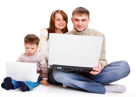 Parents with large laptop and toddler boy with a small one photo