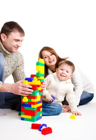 Family playing with colorful blocks Stock Photo - 8797525