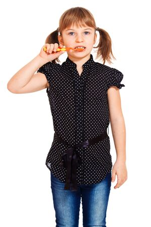 Portrait of an attractive little girl cleaning teeth Stock Photo - 8801479