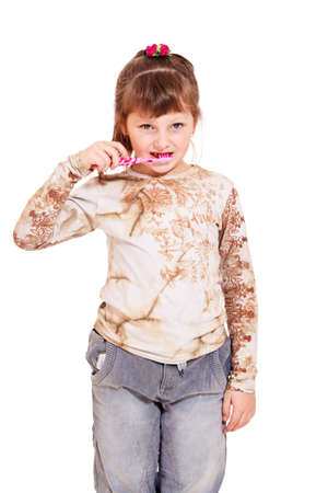 Girl brushing teeth, isolated photo
